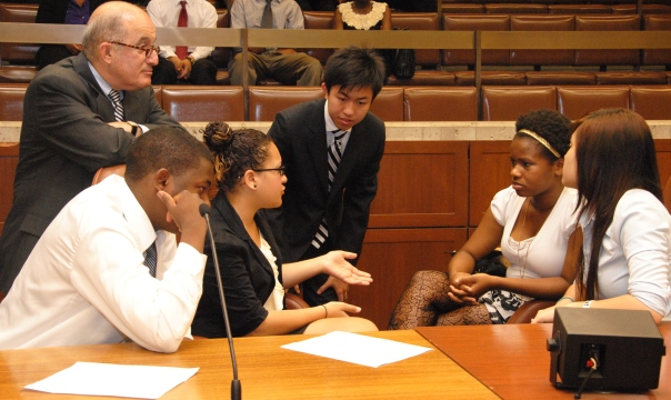 Larry DiCara, a partner at Nixon Peabody and former member and president of the Boston City Council conducts a mock City Council hearing with the 2012 Summer Jobs students. L-R: Tatenda Mundeke, Aubrey Griffin, Raymond Cen, Ashley Dixon, and Samantha Argon.