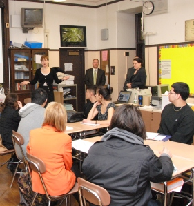 Assistant AG Claire Masinton teachs a module at East Boston High School.