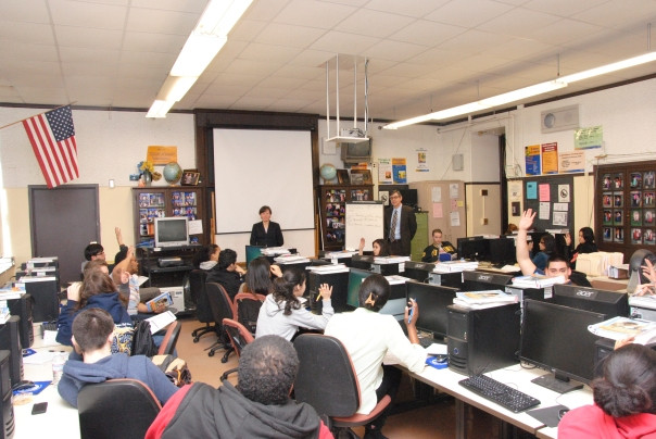 Volunteers Susan Curtin (U.S. SEC) and Jose Gonzalez (City of Boston, Office of the Corporation Counsel) teach students about using credit and credit cards.