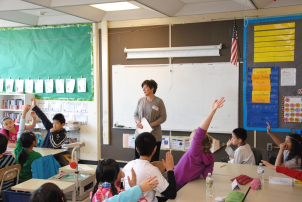 Volunteer Attorney Michelle O'Brien (Mackie Shea O'Brien, PC) asks students in Mr. Lyndon's 5th grade class at Josiah Quincy Elementary School what lawyers do.