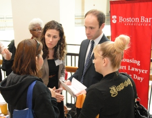 Volunteers provide legal advice to landlords and tenants as part of the Lawyer for the Day in the Boston Housing Court Program.