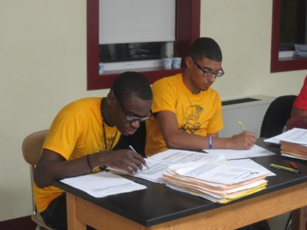 Boys Taking Notes