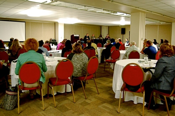 Conference attendees have a panel discussion about how to run an effective Lawyer Referral Service.