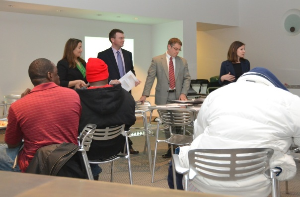 PILP gathers feedback from CARE and RESTART participants at Moakley Courthouse on Wednesday night.