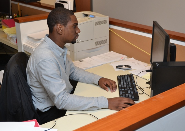 Stephan Pierre, a senior at Brighton High School, worked on an assignment at Hinckley, Allen & Snyder LLP last summer.