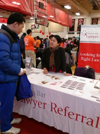 Attorney Mary Lee (Mary K.Y. Lee P.C.) speaks to an attendee about the BBA LRS, the only lawyer referral service in greater Boston approved by the American Bar Association.