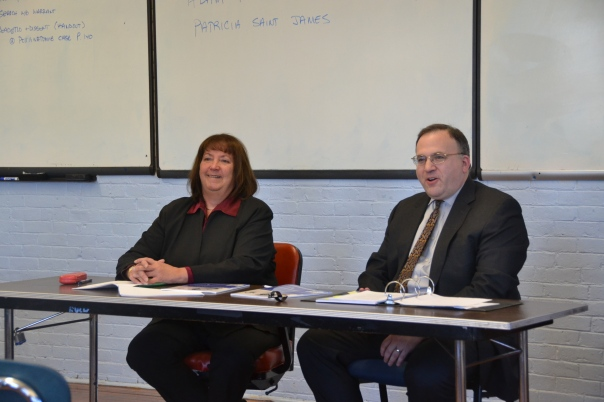 Volunteer attorneys Patricia Saint James (Looney & Grossman LLP) and Adam Ruttenberg (Looney & Grossman LLP) taught the students about using credit wisely at Another Course to College.