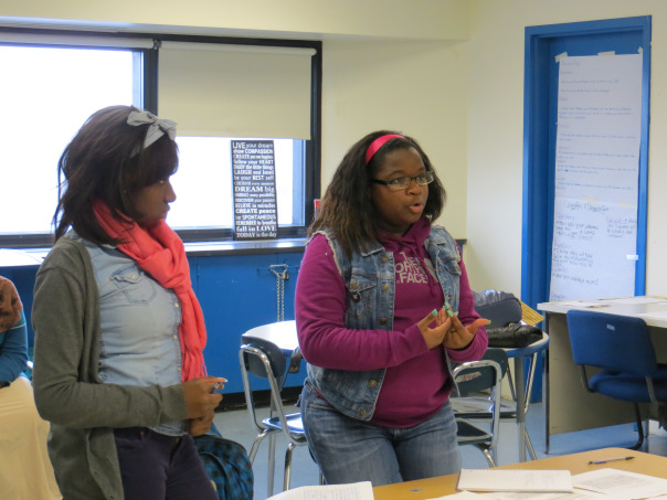 A Boston Community Leadership Academy student and a New Mission High School student debate during a Boston Debate League round.