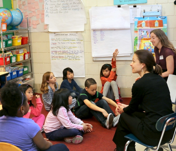 Students from Ms. Gee's 2nd grade class at Josiah Quincy Elementary School talking with attorneys Carrie Benedon and Suleyken Walker from the Office of the Massachusetts Attorney General about elections and why every vote counts.