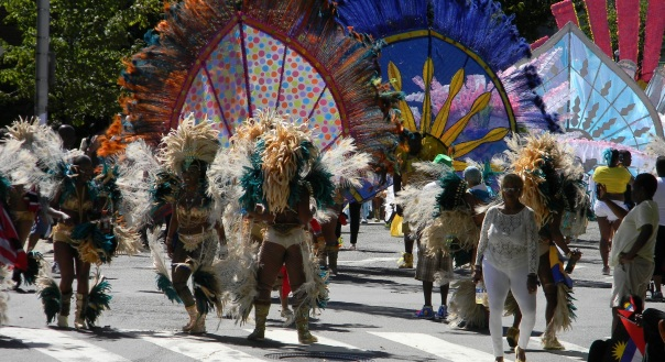 Parade participants draw from African & Caribbean roots with their costumes.